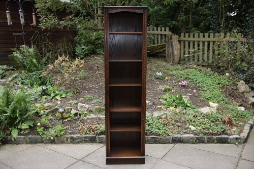 A JAYCEE CARVED OAK BOOKCASE DISPLAY CABINET WALL SHELVES.