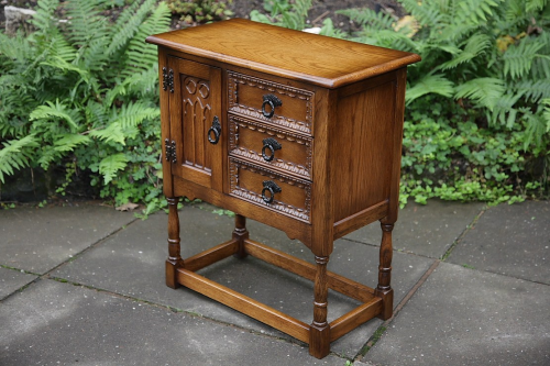 A CARVED OAK CABINET HALL TABLE POT CUPBOARD SIDEBOARD.