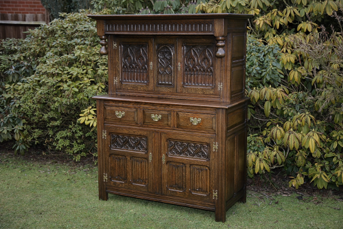 A CARVED OAK SIDEBOARD DRESSER BASE CABINET COURT CUPBOARD UNIT