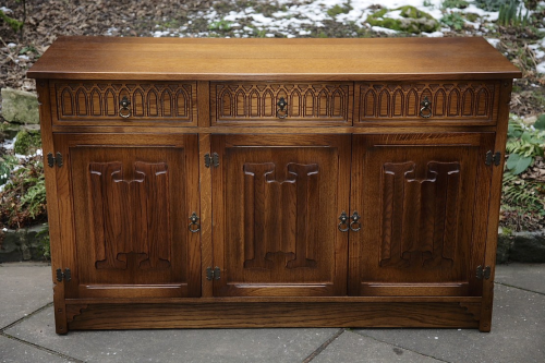 AN OLD MILL OLD CHARM JAYCEE CARVED OAK DRESSER BASE CUPBOARD SIDEBOARD CABINET HALL TABLE.