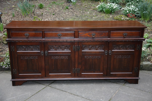 AN OLD CHARM WOOD BROS TUDOR BROWN DRESSER BASE CUPBOARD SIDEBOARD CABINET SERVER TABLE.