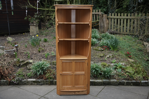AN ERCOL LIGHT ELM CORNER DISPLAY CABINET CUPBOARD SHELVES BOOKCASE STAND TABLE.