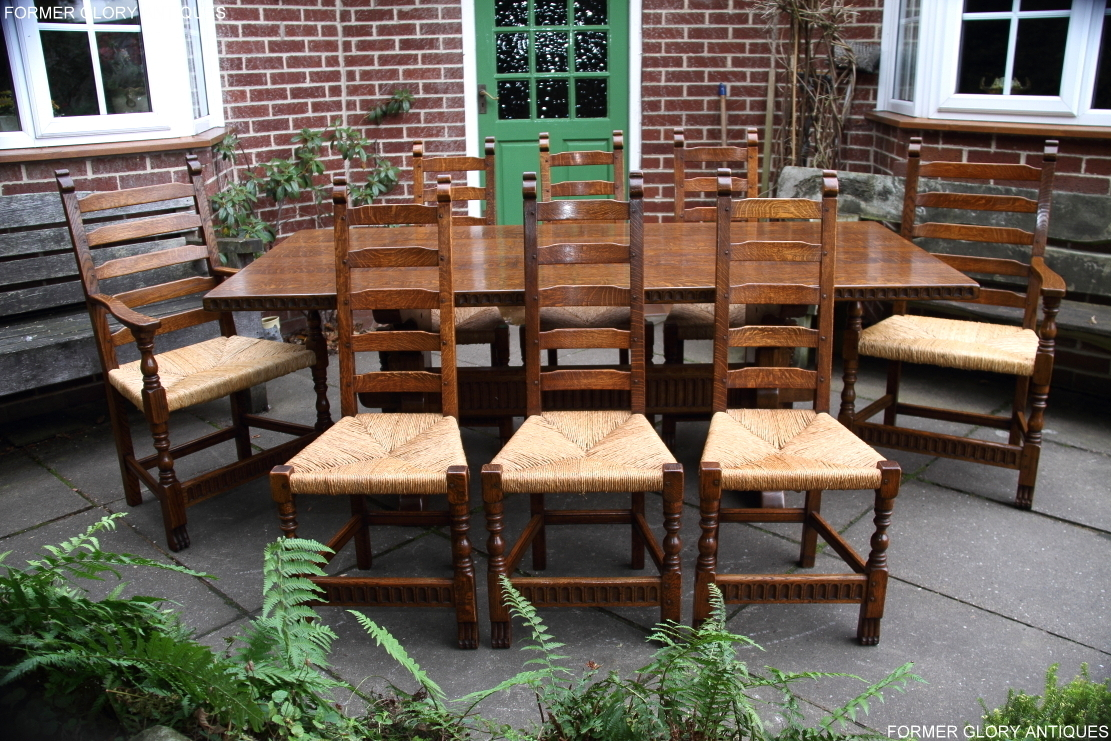 RUPERT NIGEL GRIFFITHS MONASTIC CARVED OAK DINING TABLE AND A SET OF EIGHT  MATCHING DINING CHAIRS ...