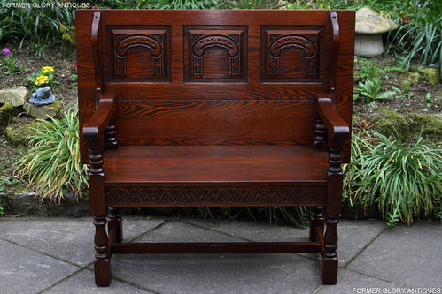 A WOOD BROTHERS OLD CHARM TUDOR BROWN CARVED OAK MONKS BENCH SETTLE PEW