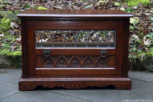 A WOOD BROTHERS OLD CHARM TUDOR BROWN CARVED OAK TV CABINET STAND
