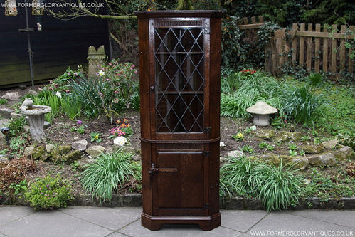 A RUPERT / NIGEL GRIFFITHS OAK CORNER DISPLAY CABINET