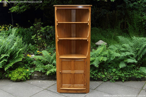 AN ERCOL LIGHT ELM CORNER DISPLAY CABINET / CUPBOARD