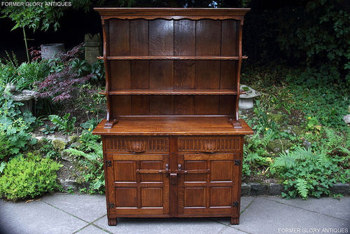A RUPERT / NIGEL GRIFFITHS MONASTIC CARVED OAK DRESSER