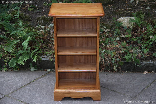 AN ERCOL LIGHT ELM CD STORAGE CABINET