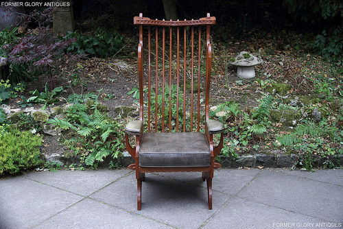 A RUPERT / NIGEL GRIFFITHS CARVED OAK DERBYSHIRE WING BACK LEATHER / ARMCHAIR