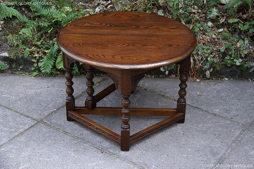 A WOOD BROTHERS OLD CHARM LIGHT OAK COFFEE / DROP LEAF TABLE