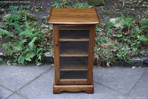AN ERCOL GOLDEN DAWN ELM CD STORAGE CABINET