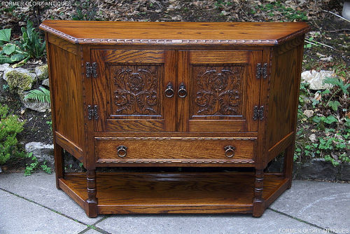 A JAYCEE AUTUMN GOLD CARVED OAK CANTED CABINET / SIDEBOARD