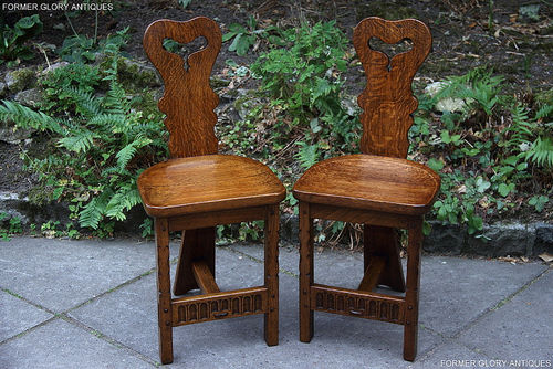 A PAIR OF RUPERT / NIGEL GRIFFITHS MONASTIC OAK COTTAGE HALL CHAIRS