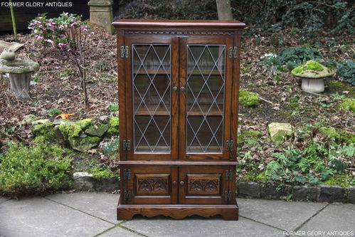 A WOOD BROTHERS OLD CHARM LIGHT OAK BOOKCASE / DISPLAY CABINET