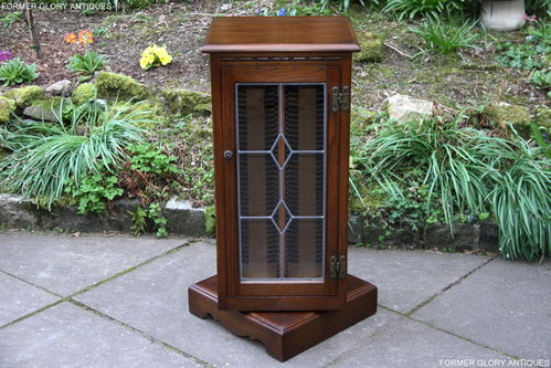 A WOOD BROTHERS OLD CHARM LIGHT OAK REVOLVING CD CABINET / STAND