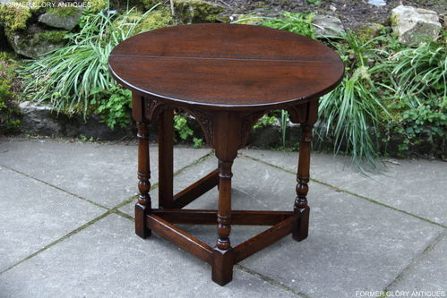 A CHINGFORD REPRODUCTIONS CARVED OAK DROP LEAF COFFEE TABLE