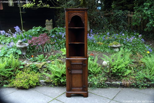 A TITCHMARSH AND GOODWIN CARVED OAK MINIATURE CORNER DISPLAY CABINET / CUPBOARD