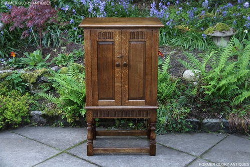 A RUPERT / NIGEL GRIFFITHS MONASTIC CARVED OAK DRINKS CABINET / CUPBOARD