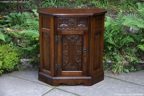 A WOOD BROTHERS OLD CHARM CARVED LIGHT OAK CANTED CABINET / CUPBOARD