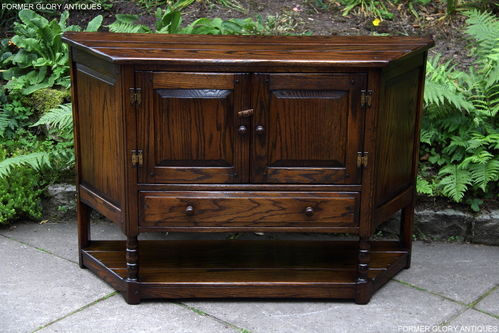 A JAYCEE MELLOW OAK CANTED HALL CABINET / CUPBOARD / SIDEBOARD