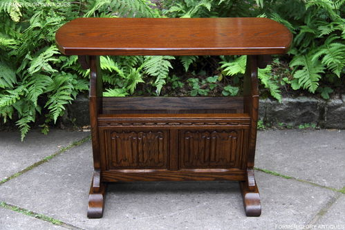A WOOD BROTHERS OLD CHARM CARVED LIGHT OAK COFFEE TABLE / MAGAZINE RACK