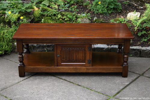 A WOOD BROTHERS OLD CHARM LIGHT OAK LONG COFFEE TABLE WITH CUPBOARD