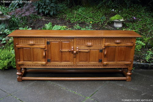 A RUPERT GRIFFITHS MONASTIC WOODCRAFT CARVED OAK SIDEBOARD / DRESSER BASE