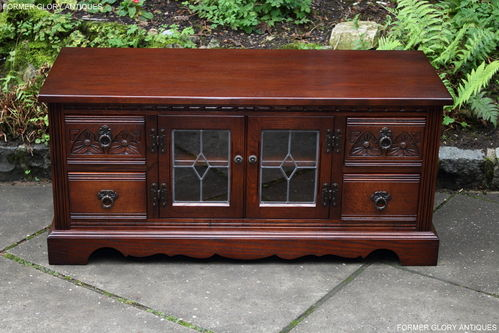 A WOOD BROTHERS OLD CHARM TUDOR BROWN CARVED OAK TV CABINET / STAND / BASE