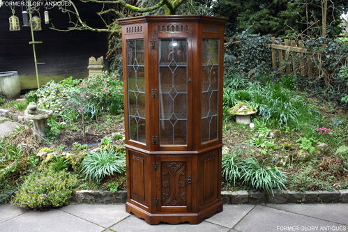 A WOOD BROTHERS OLD CHARM CARVED LIGHT OAK CANTED DISPLAY CABINET / DRESSER
