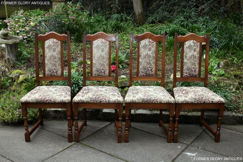 A SET OF FOUR WOOD BROTHERS OLD CHARM LIGHT OAK UPHOLSTERED DINING CHAIRS