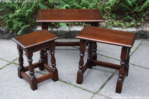 A WOOD BROTHERS OLD CHARM TUDOR BROWN OAK NEST OF THREE TABLES / COFFEE TABLE SET
