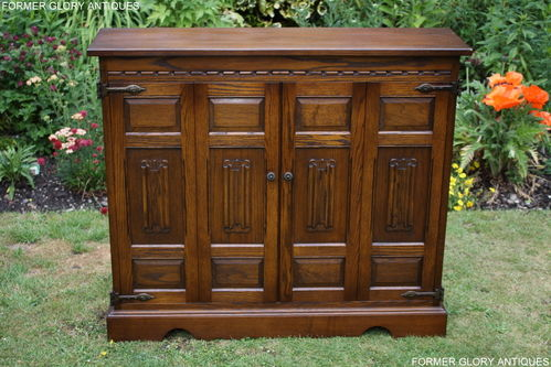 A WOOD BROTHERS OLD CHARM CARVED LIGHT OAK CD STORAGE CABINET
