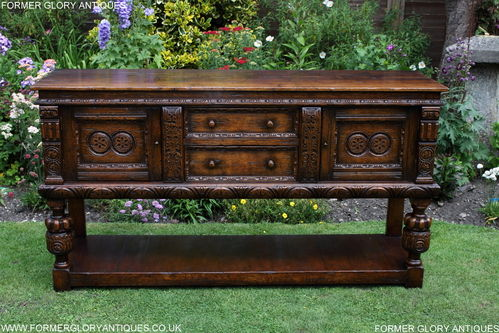 A TITCHMARSH AND GOODWIN JACOBEAN CARVED OAK DRESSER BASE / SIDEBOARD