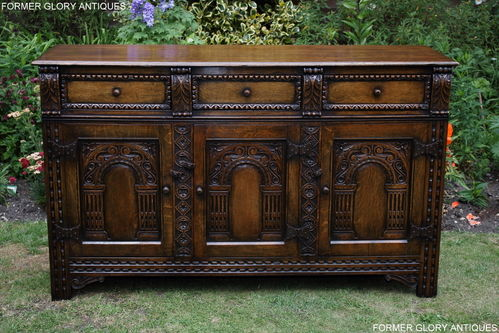 A TITCHMARSH AND GOODWIN STYLE JACOBEAN CARVED OAK DRESSER BASE / SIDEBOARD