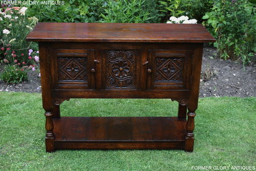 A TITCHMARSH AND GOODWIN STYLE JACOBEAN CARVED OAK DRESSER BASE / SIDEBOARD / CREDENCE CABINET