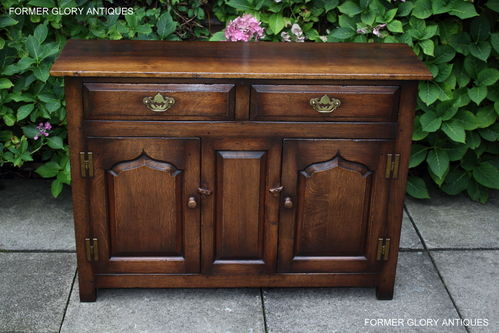 A TITCHMARSH AND GOODWIN JACOBEAN STRESSED OAK DRESSER BASE / SIDEBOARD / HALL CABINET