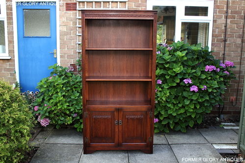 A WOOD BROTHERS OLD CHARM TUDOR BROWN CARVED OAK OPEN BOOKCASE / DISPLAY CABINET