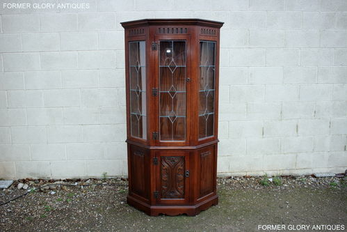 A WOOD BROTHERS OLD CHARM TUDOR BROWN CARVED OAK CANTED DISPLAY CABINET / DRESSER