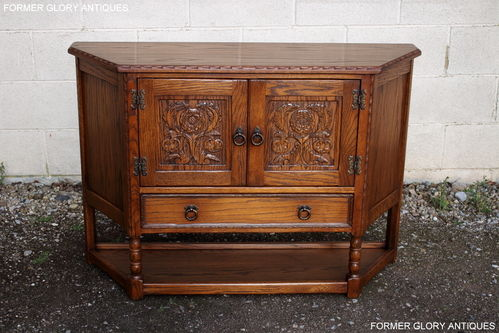 A JAYCEE AUTUMN GOLD CARVED OAK CANTED HALL CUPBOARD / SIDEBOARD