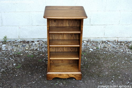 AN ERCOL GOLDEN DAWN ELM CD STORAGE / DISPLAY CABINET / SHELVES / STAND