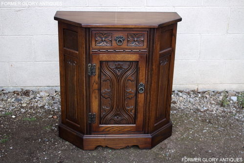 A WOOD BROTHERS OLD CHARM CARVED LIGHT OAK CANTED PEDESTAL CABINET / HALL CUPBOARD
